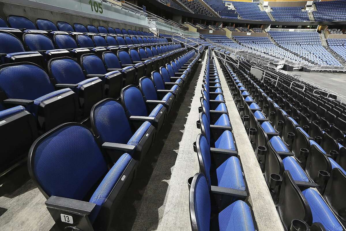 """The seats are empty at the Amway Center in Orlando, home of the NBA's Orlando Magic, on Thursday, March 12, 2020. The NBA has suspended its season """"until further notice"""" after a Utah Jazz player tested positive Wednesday for the coronavirus, a move that came only hours after the majority of the league's owners were leaning toward playing games without fans in arenas. (Stephen M. Dowell /Orlando Sentinel via AP)"""
