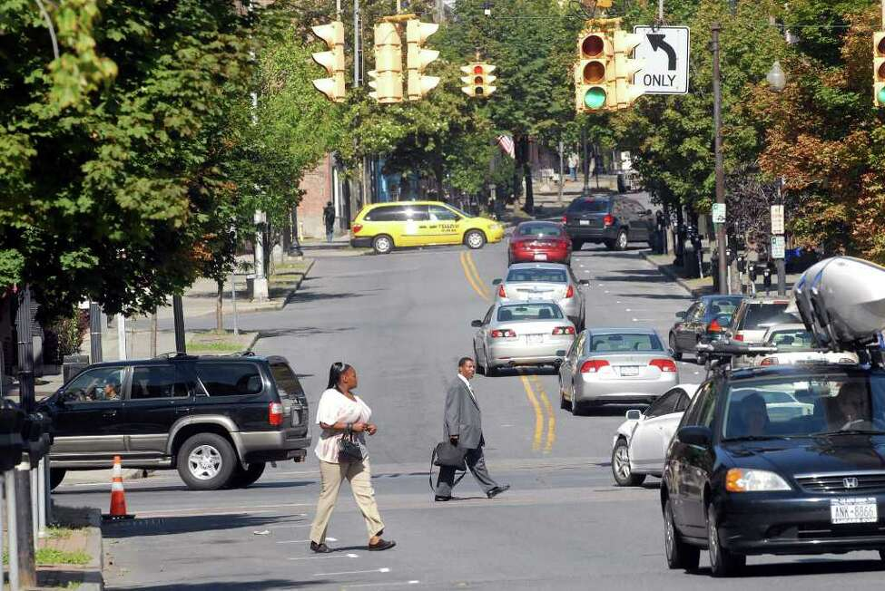 S. Pearl Street & Madison Avenue Red light camera violations issued in 2018: 135 Cars and pedestrians mix at the intersection of Madison Ave. and South Pearl St. in Albany, NY on Tuesday, Aug. 18, 2010. (Paul Buckowski / Times Union)