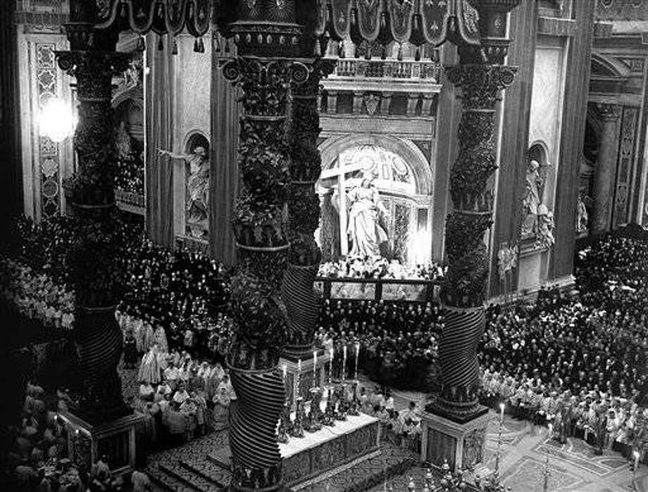 Coronation of Pope Pius XII took place on March 12, accompanied by the long and gorgeous traditional ceremonial at St. Peters, Rome. A General view of the scene in St. Peters, Rome on March 12, 1939, as the Pope, seen in left foreground, celebrated mass immediately prior to his actual coronation. (AP Photo)