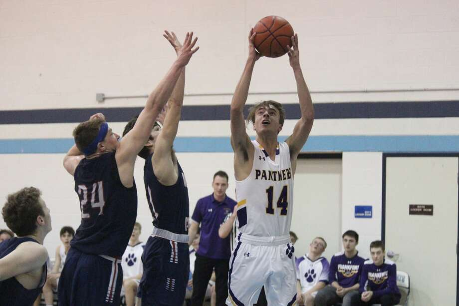 Luke Hammon drives to the basket for layup during the second half of Frankfort's victory over Manistee Catholic. Photo: Robert Myers
