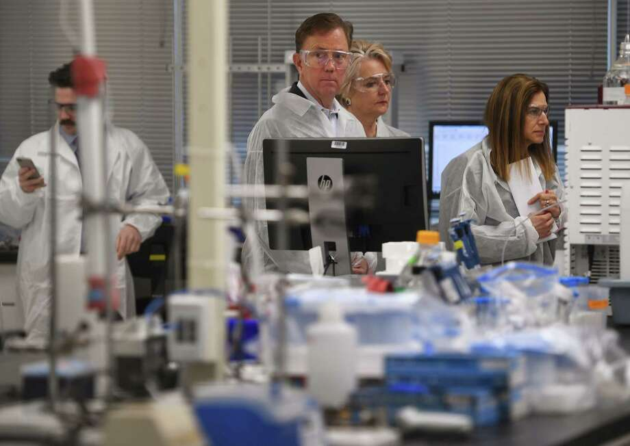 Governor Ned Lamont and Lt. Governor Susan Bysiewicz tour the lab at Protein Sciences Corp. in Meriden, Conn. on Thursday, March 12, 2020. The company is working on a vaccine for the coronavirus. Photo: Brian A. Pounds, Hearst Connecticut Media / Connecticut Post