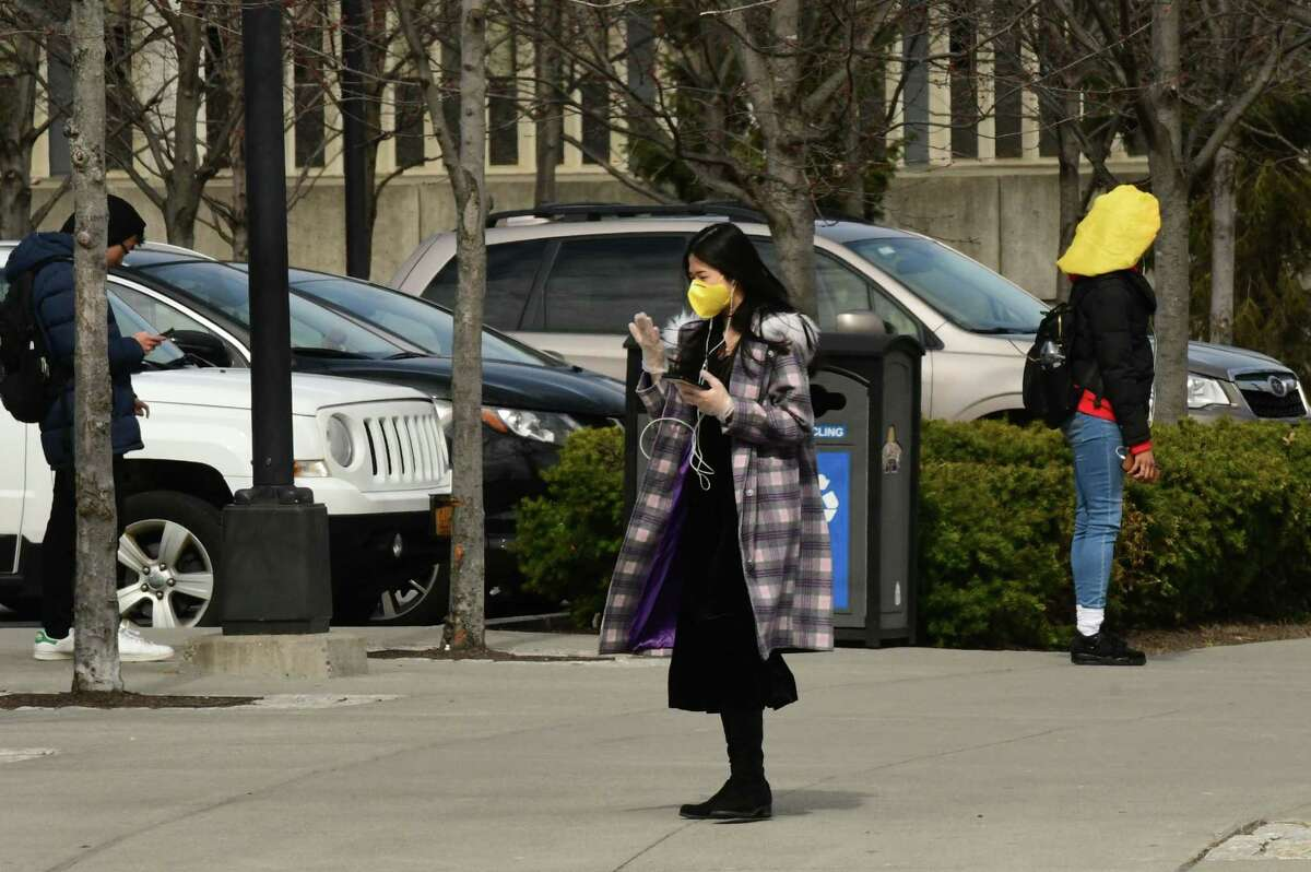 Students wait for buses at the Collins Circle bus stop at University at Albany on Thursday, March 12, 2020 in Albany, N.Y. Some students were wearing face masks due to the coronavirus cases. (Lori Van Buren/Times Union)