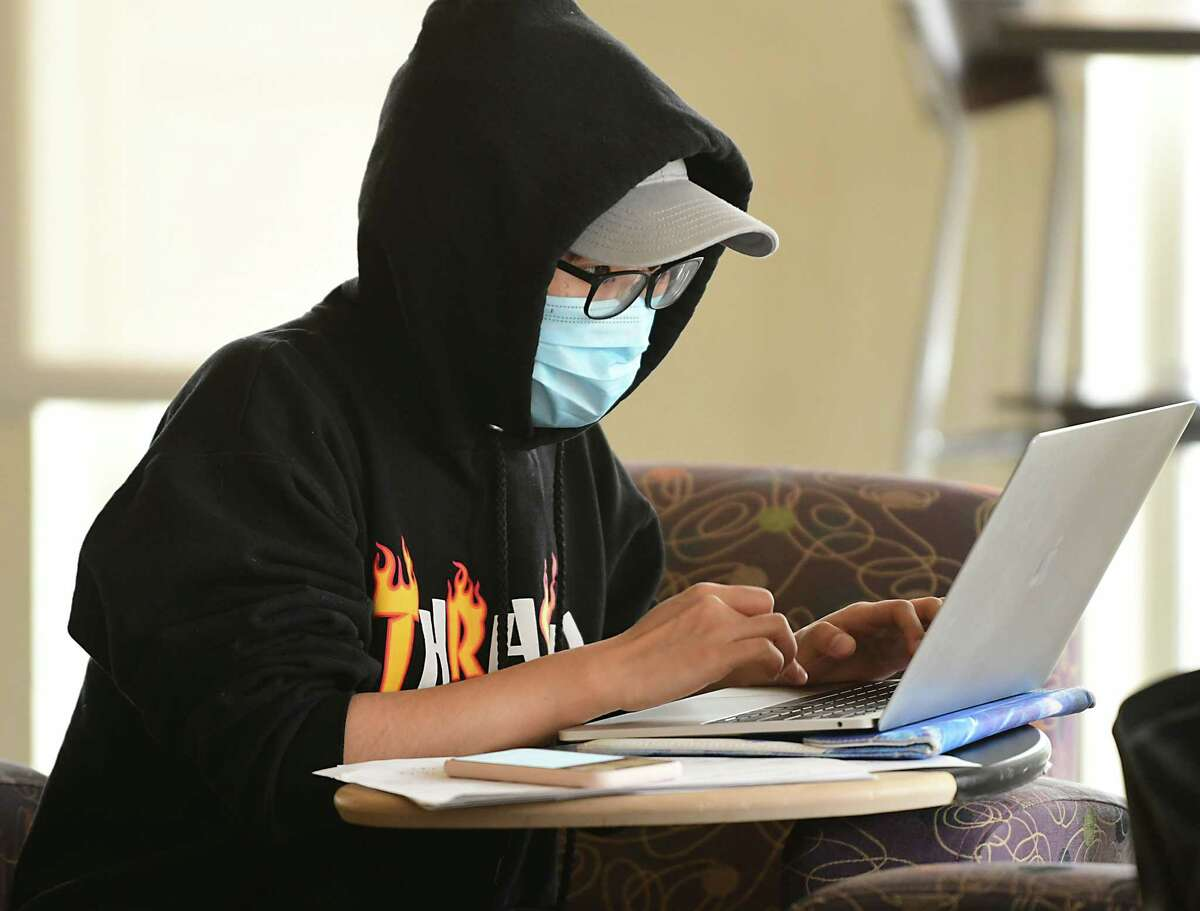 University at Albany student Amber Lee of China studies in the Campus Center at UAlbany on Thursday, March 12, 2020 in Albany, N.Y. Some students were wearing face masks due to the coronavirus cases. (Lori Van Buren/Times Union)