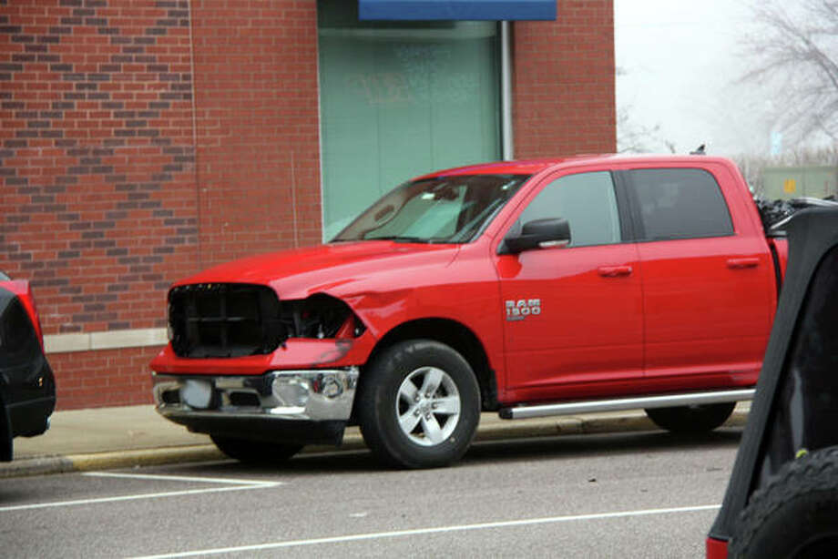This pickup needs a new grille and headlights after a MCT bus struck it Thursday morning. Photo: Charles Bolinger|The Intelligencer