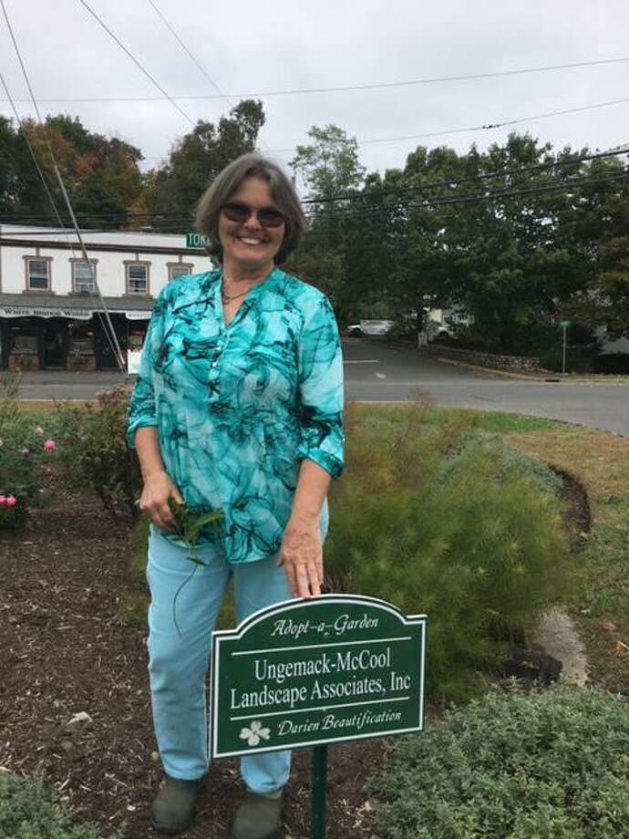 Sarah Ungemack McCool at the garden she maintains at Fine Mile River Road and Tokeneke Road. Photo: Contributed