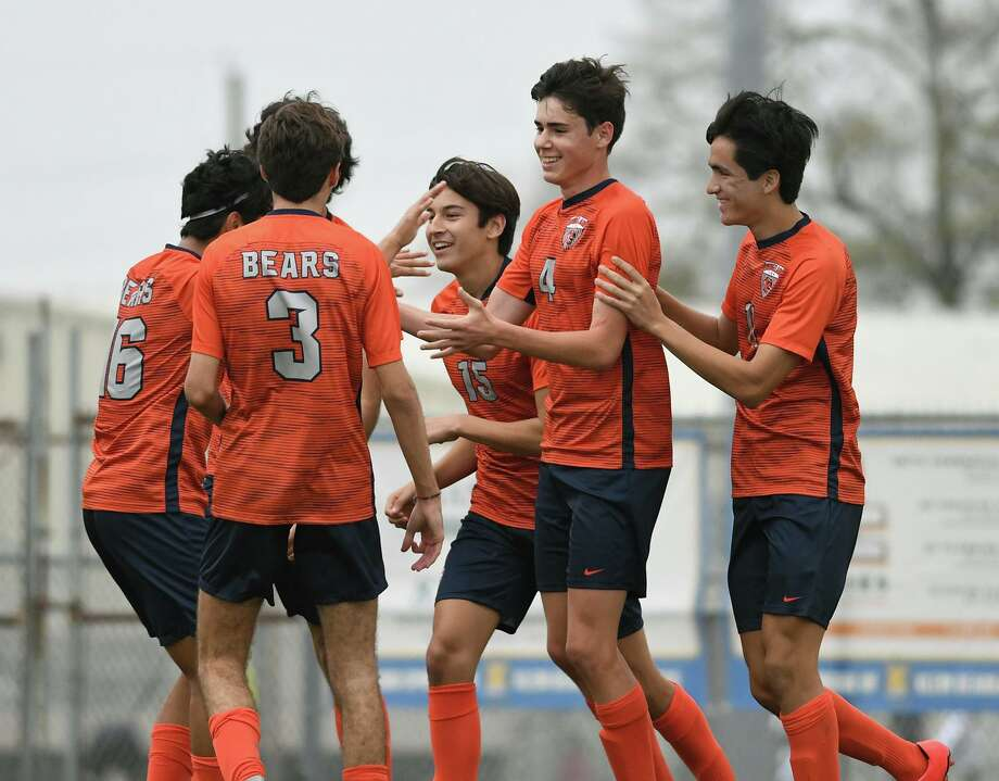 Bridgeland junior defender Luke DeLancey, second from right, celebrates his goal scored against Klein Cain with teammates Josue Otero, left, Carter Crawford (3), Ian Inigo (15), and Andy Corrales, right, during their matchup in the Klein Showcase Varsity Soccer Tournament at Klein Memorial Stadium on Jan. 10, 2020. Photo: Jerry Baker, Houston Chronicle / Contributor / Houston Chronicle