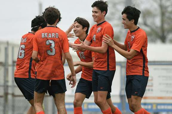 Bridgeland junior defender Luke DeLancey, second from right, celebrates his goal scored against Klein Cain with teammates Josue Otero, left, Carter Crawford (3), Ian Inigo (15), and Andy Corrales, right, during their matchup in the Klein Showcase Varsity Soccer Tournament at Klein Memorial Stadium on Jan. 10, 2020.
