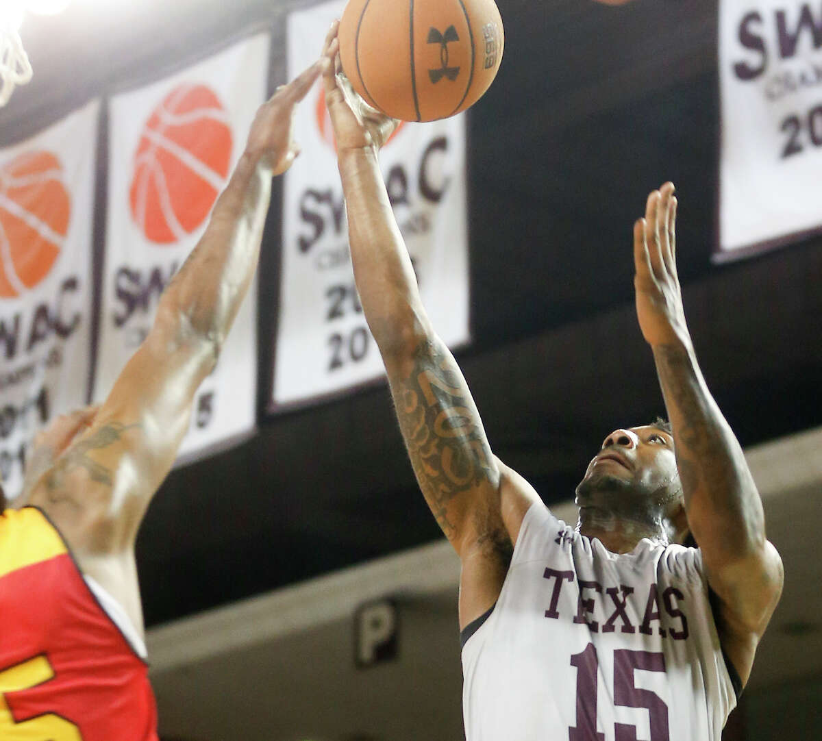 Texas Southern Tigers forward Justin Hopkins (15) drives to the basket against Grambling State Tigers forward DeVante Jackson (25) in the SWAC Basketball Tournament at TSU's Health and Physical Education Arena on Tuesday, March 10, 2020. TSU won the game 75-62.