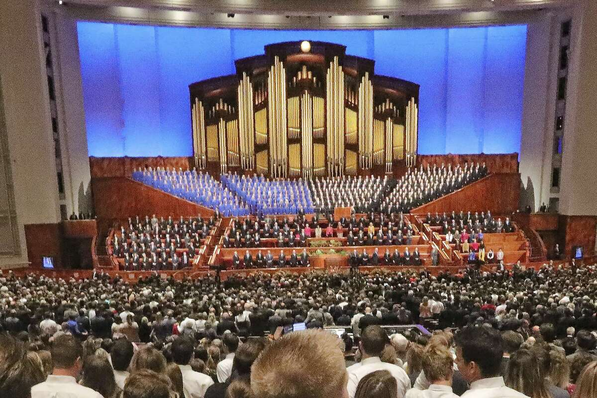 FILE - In this Oct. 5, 2019, file photo, conference goers listen during The Church of Jesus Christ of Latter-day Saints' twice-annual church conference in Salt Lake City. The Church of Jesus Christ of Latter-day Saints announced Wednesday, March 11, 2020, that it will hold its major conference in April that features speeches by top leaders without any attendees because of the spread of the coronavirus. The twice-yearly conference usually brings about 100,000 to Salt Lake City over two days, but instead the speeches will only be broadcast via television and the internet. (AP Photo/Rick Bowmer, File)