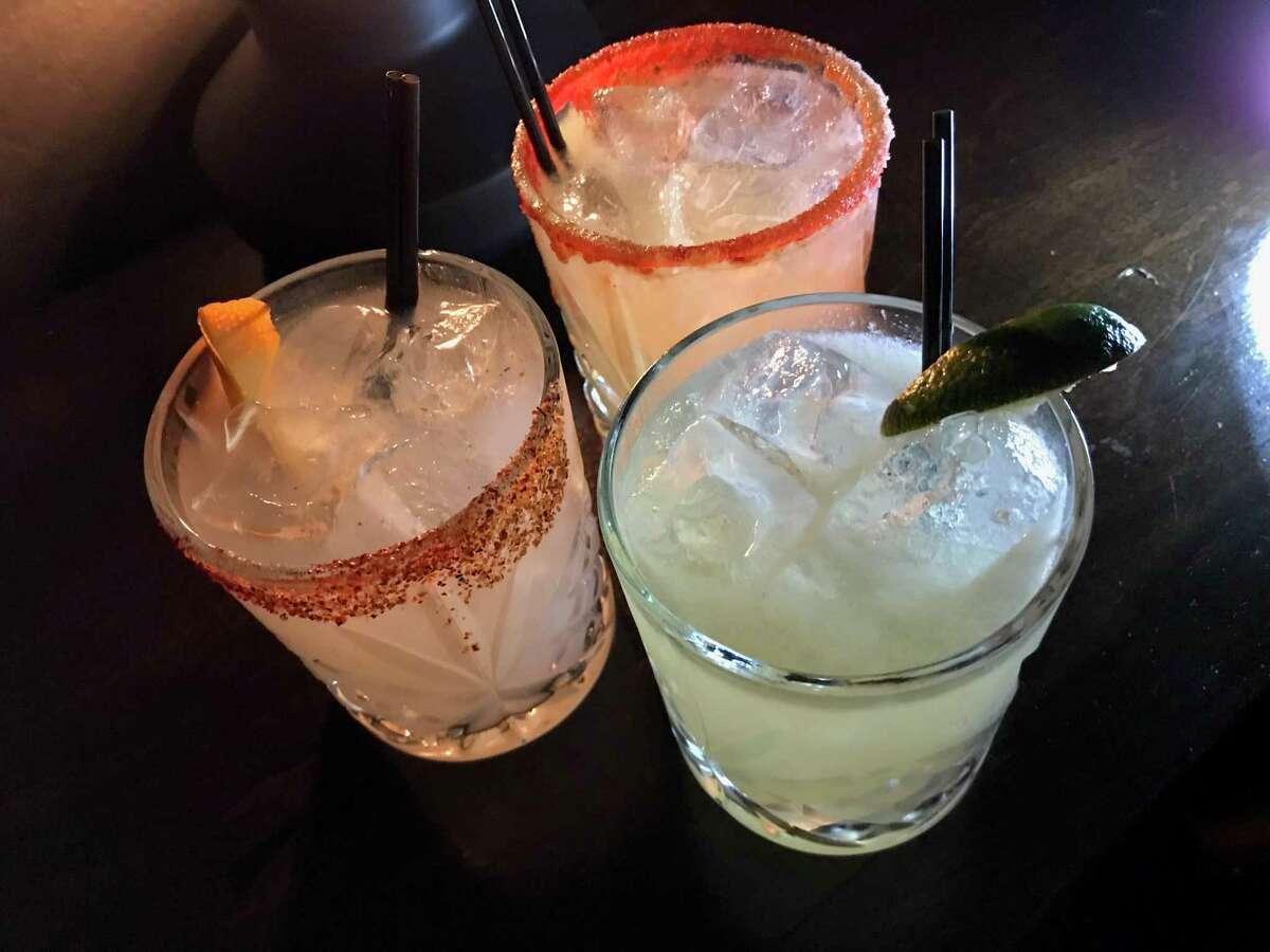 Clockwise from left, the Santiago, El Diablo and Oaxaca Margarita cocktails at Espuelas