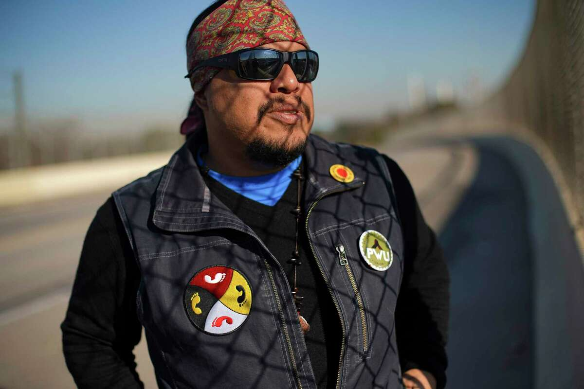 """Bryan Parras leads a """"toxic tour"""" of the Manchester neighborhood, surrounded by oil and gas refineries along the Houston Ship Channel. Originally called a """"good buy"""" for workers in the 1920s, the neighborhood today is home to mostly Latinos and Spanish-speaking immigrants."""