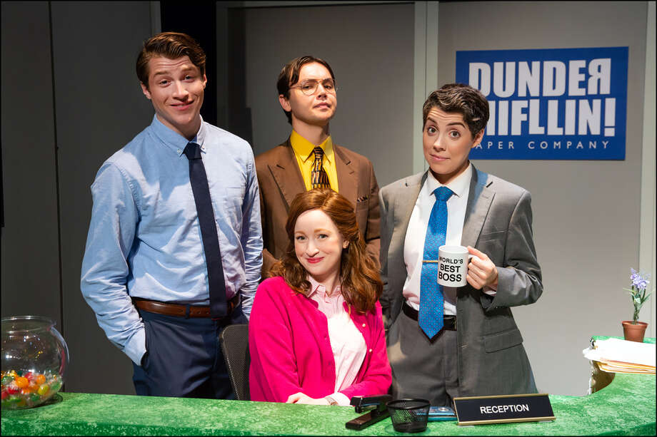 Patrick Constant as Jim Halpert, from left, Christian Fary as Dwight Schrute, Madeline Glenn Thomas as Pam Halpert and Emma Brock as Michael Scott pose on the set of The Office! A Musical Parody.