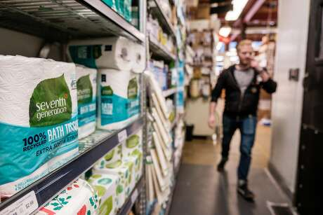 Toilet paper and paper towels are seen on the shelves at the Bi-Rite store in San Francisco, Calif. on Friday, March 6, 2020.