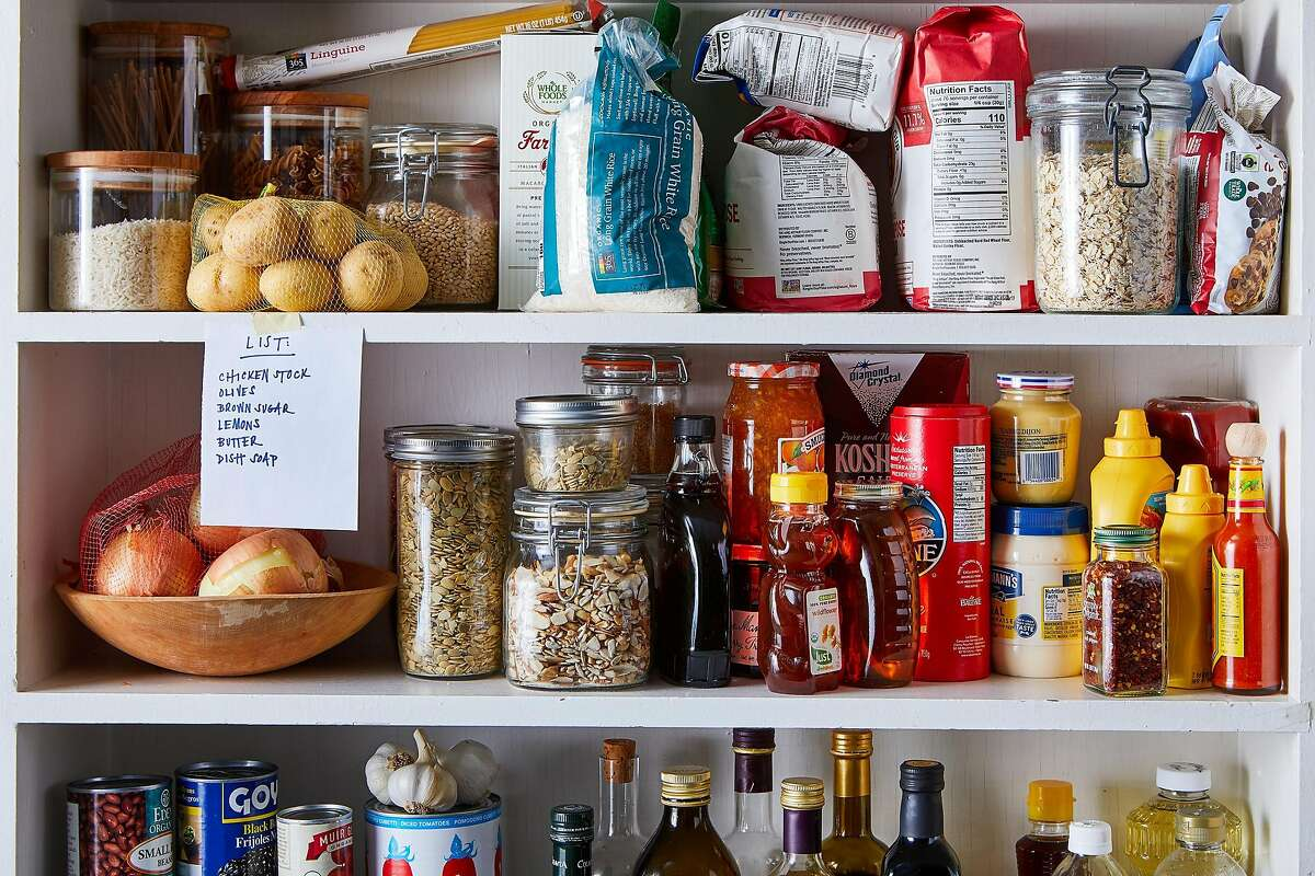 FILE -- A variety of food on the shelves of a pantry, in New York, Jan. 17, 2019. Having a well-stocked pantry is always a good idea, whether you're looking to throw together pasta with anchovies when there's nothing in the fridge, or you want to avoid going grocery shopping when the weather is vile. Prop Stylist: Kristine Trevino. (Julia Gartland for The New York Times)