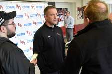 Rensselaer Polytechnic Institute hockey coach Dave Smith, center, talks to the media after finding out they had to pull their team out of the ECAC Tournament on Thursday, March 12, 2020 in Albany, N.Y. RPI's hockey team is now done for the season. (Lori Van Buren/Times Union)