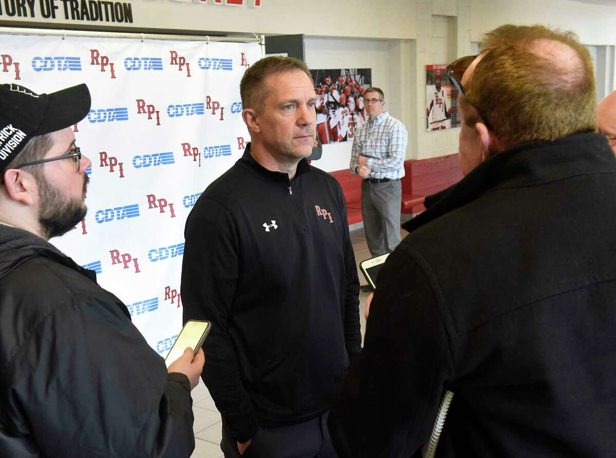 RPIhockey coach Dave Smith, center, shown talking to the media back in March when the team pulled out of the ECAC Tournament, is still hopeful there will be games this season.(Lori Van Buren/Times Union)