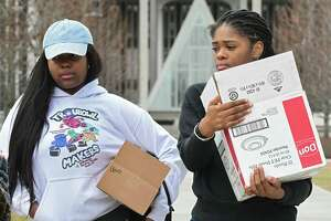 University at Albany sophomores Kelsey Wright, left, and Carissa Alexander, both from Brooklyn, carry their belongings at UAlbany on Thursday, March 12, 2020 in Albany, N.Y. The school is taking precautions due to a coronavirus case. (Lori Van Buren/Times Union)