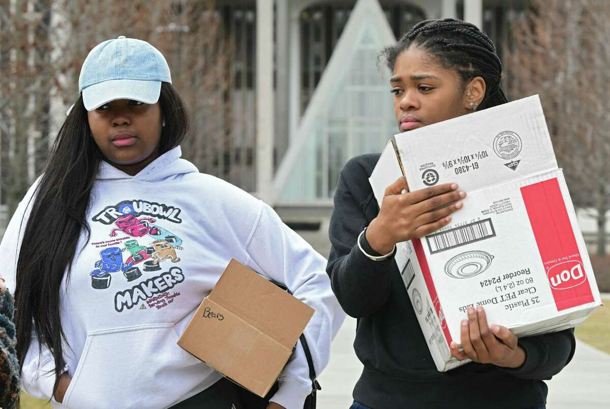 University at Albany sophomores Kelsey Wright, left, and Carissa Alexander, both from Brooklyn, carry their belongings at UAlbany on Thursday, March 12, 2020 in Albany, N.Y. (Lori Van Buren/Times Union)