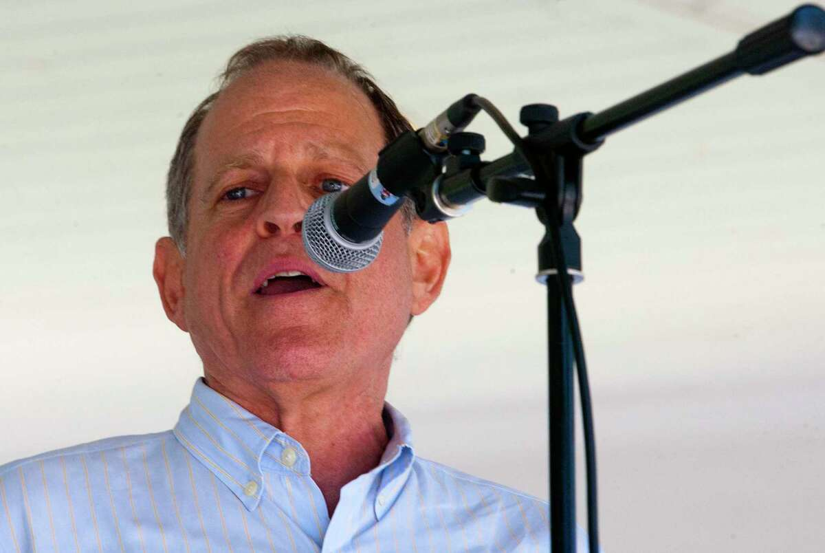 Fairfield DTC Chair Steve Sheinberg speaks as hundreds of area residents gather at Sherman Green to take part in the nationwide Families Belong Together Day in Fairfield, Conn., on Saturday June 30, 2018. ICT4 - Indivisible Connecticut 4 joined organizations across the country on Saturday to protest the immigration policies of President Donald Trump.