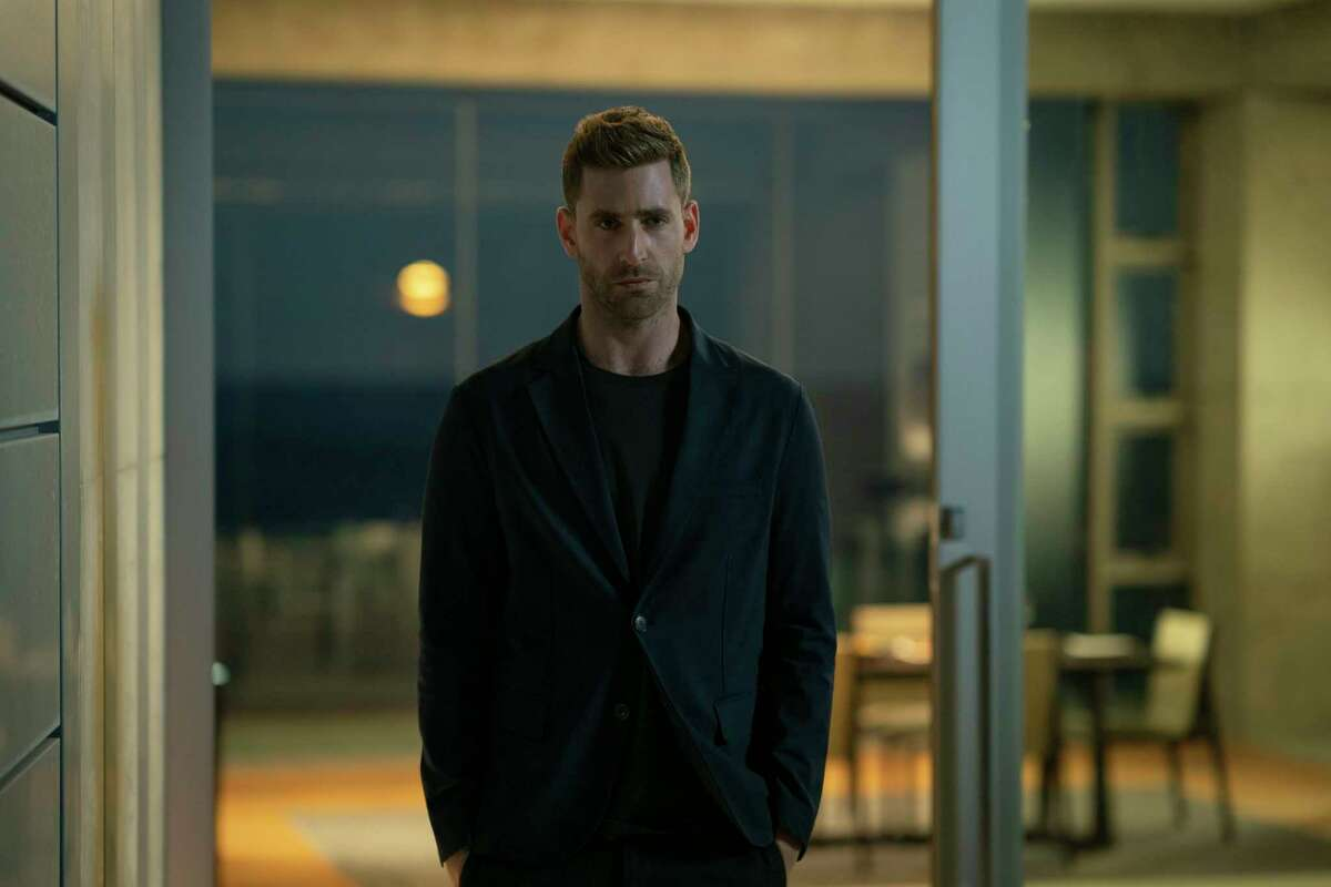 """This image released by Universal Pictures shows Oliver Jackson-Cohen in a scene from """"The Invisible Man."""" (Mark Rogers/Universal Pictures via AP)"""