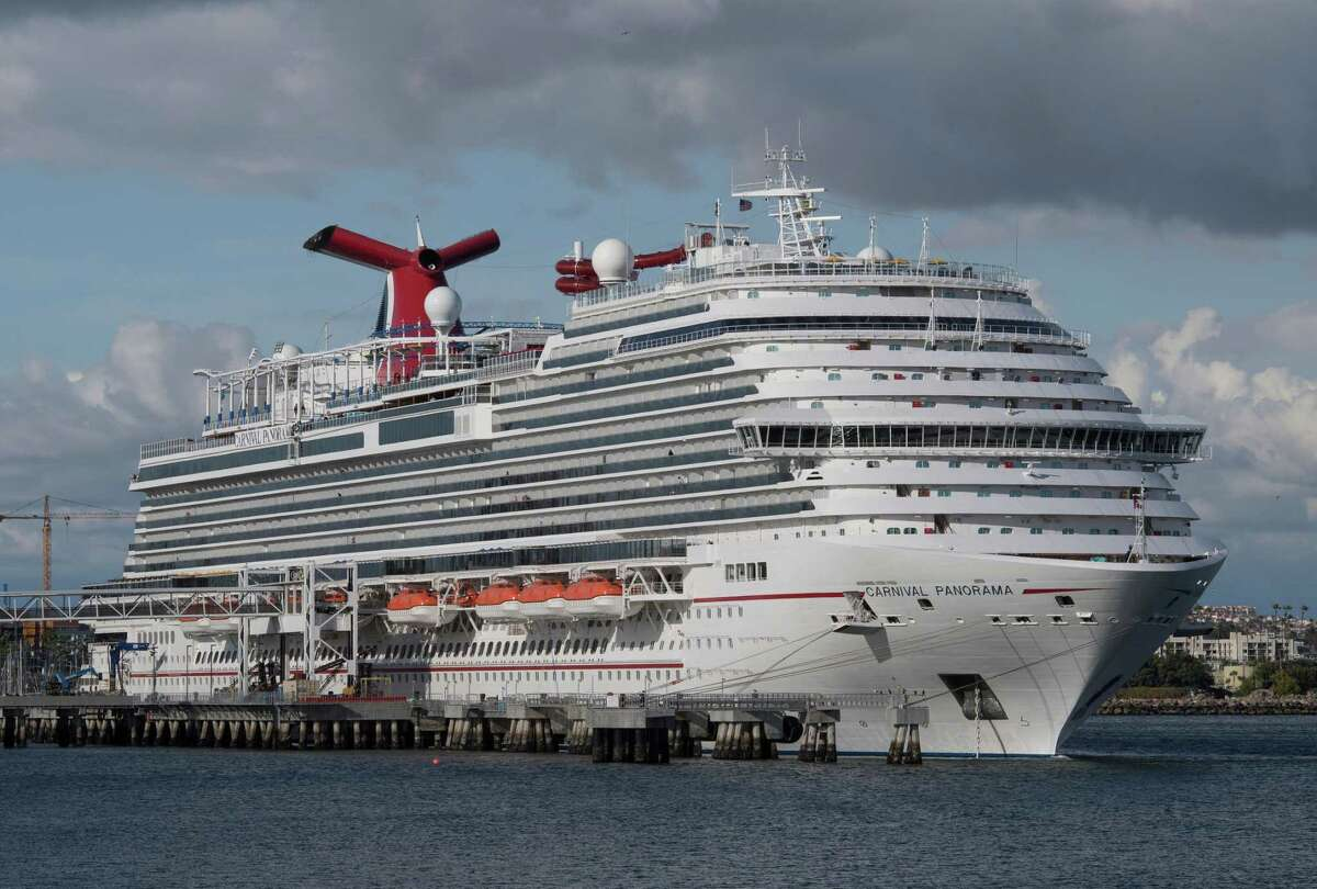 A Carnival Panorama cruise ship is seen docked in Long Beach, California on March 7, 2020, as passengers await onboard for the results of a COVID-19 (Coronavirus) test given to an ill passenger. - Long Beach city officials said on Twitter that a passenger aboard the cruise was taken to a local hospital by the Long Beach Fire Department and is being tested for the coronavirus. The ship is docked at a Long Beach terminal, but