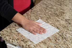 University of Houston professor Sujata Sirsatmakes wipes kitchen counter with disinfecting wipes in her house on Friday March 6, 2020 in Sugar Land, Texas.