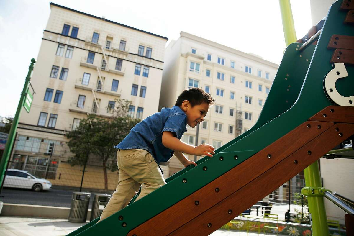 Cesar Arqueta, 3, climbs up the slide before sliding down it as he plays at the new Turk and Hyde Mini Park on Thursday, March 5, 2020 in San Francisco, Calif.