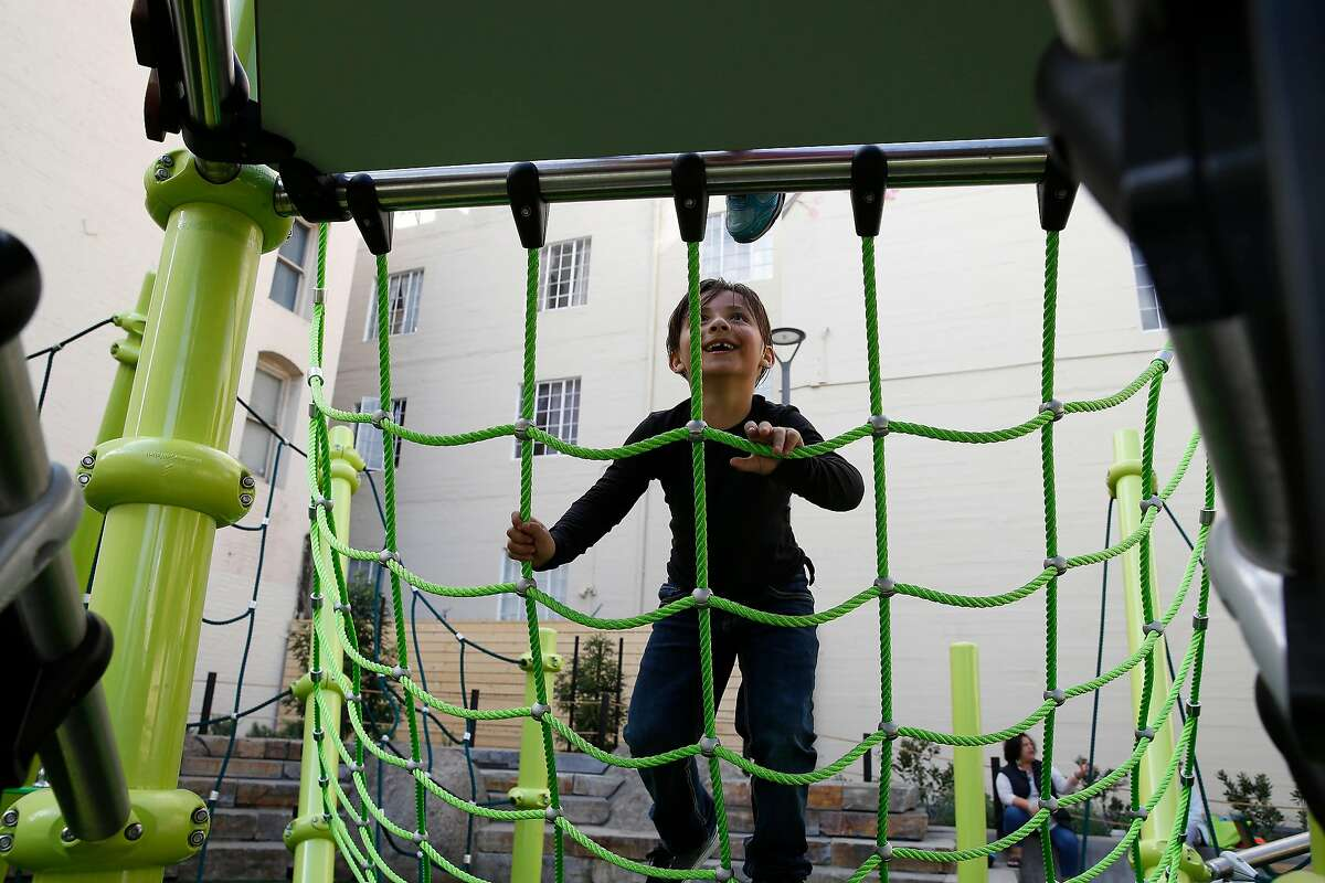 Carlitos Vasquez, 6, climbs the new play structure at the new Turk and Hyde Mini Park on Thursday, March 5, 2020 in San Francisco, Calif.
