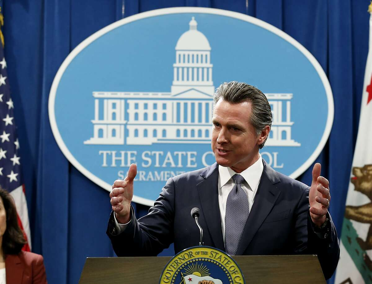 California Gov. Gavin Newsom speaks to reporters about his executive order advising that non-essential gatherings of more than 250 people should be canceled until at least the end of March, during a news conference in Sacramento, Calif., Thursday, March 12, 2020. (AP Photo/Rich Pedroncelli)