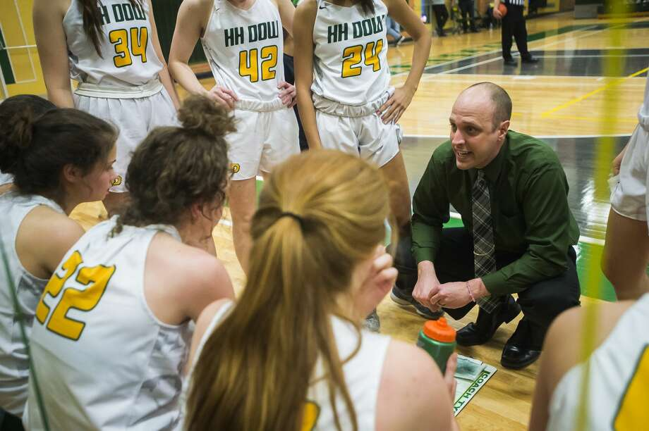 Dow High girls' basketball coach Kyle Theisen addresses his team during a timeout in a March 6, 2020 district final against Midland High. Photo: Katykildee/kildee@mdn.net