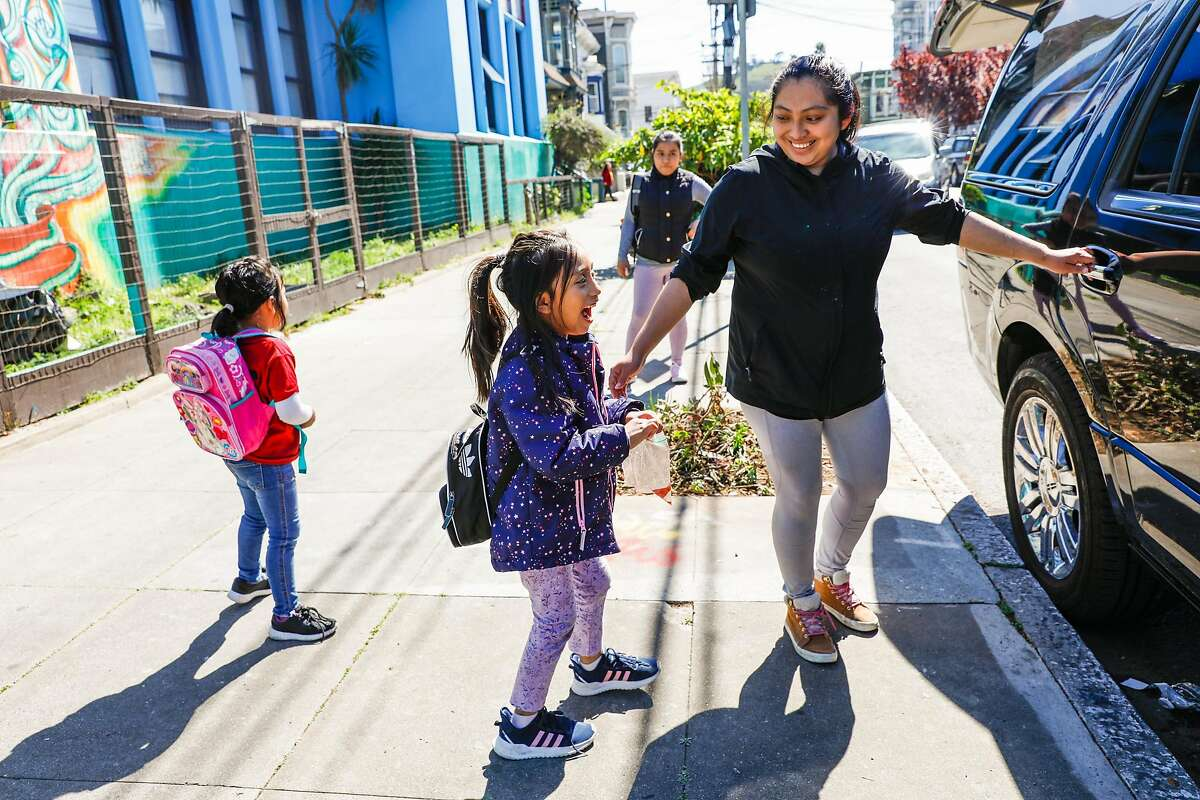 Claudia Mendez (right) picks up daughter Natalie Cetina, 6 (left) from Cesar Chavez Elementary School on Thursday, March 12, 2020 in San Francisco, California. There are concerns with keeping schools open as the coronavirus continues to spread throughout the country and California.
