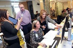 From left, Samantha Fonda, Joshua Williston, Betsy Hine and Stacey Lane collaborate with calls at the Covid-19 call center in Yale New Haven Hospital on March 12.