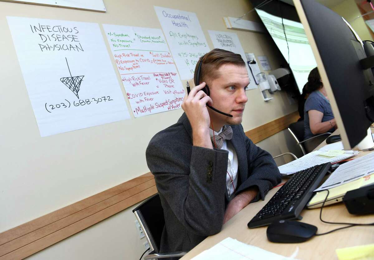 Dr. David Gaston, infectious disease clinical fellow, answers calls at the Covid-19 call center at Yale New Haven Hospital on March 12.