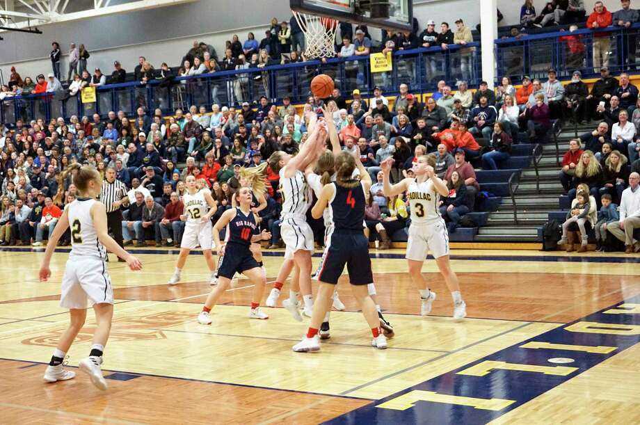 The Big Rapids and Cadillac girls basketball teams square off in front of a near-capacity crowd at Cadillac High School during last week's District 35 championship game. (Pioneer file photo/Joe Judd)