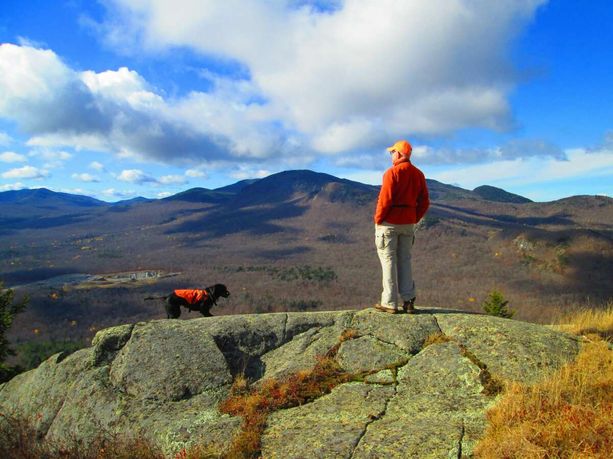 Alan and Toby on Mount Fay, looking at Bluff Mountain. (Courtesy of Jim Hopson)