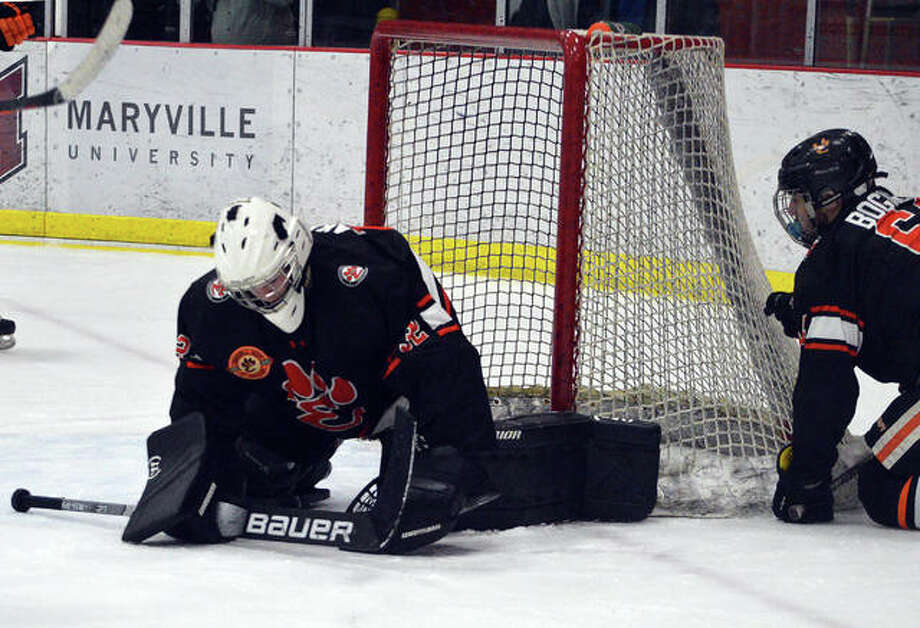 Edwardsville goalie Jonas Akeman makes a save during the 2019-20 season. Photo: Scott Marion|The Intelligencer