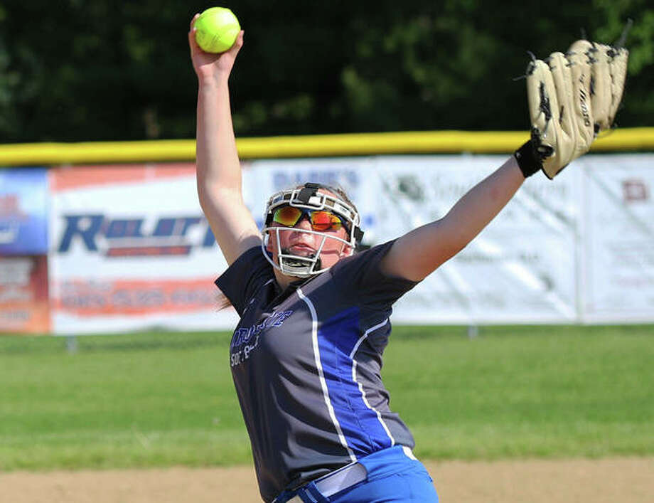 Taylor Whitehead delivers a pitch during a start last season for Marquette Catholic softball. Whitehead, who posted a 38-7 record in three seasons for the Explorers, has transferred to East Alton-Wood River for her senior season. Photo: Greg Shashack / The Telegraph