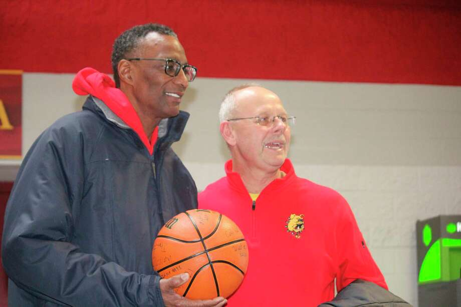 Former NCAA and NBA standout Greg Kelser (left) takes a photo with local sports fan Randy LaPreze after a recent Ferris basketball game. (Pioneer photo/John Raffel)
