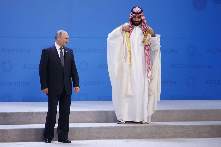 FILE -- President Vladimir Putin of Russia, left, and Crown Prince Mohammed bin Salman of Saudi Arabia, right, while gathering with other world leaders for a group photo at the G-20 summit, at the InterContinental hotel in Buenos Aires, Argentina, Nov. 30, 2018. Photo: Tom Brenner, NYT