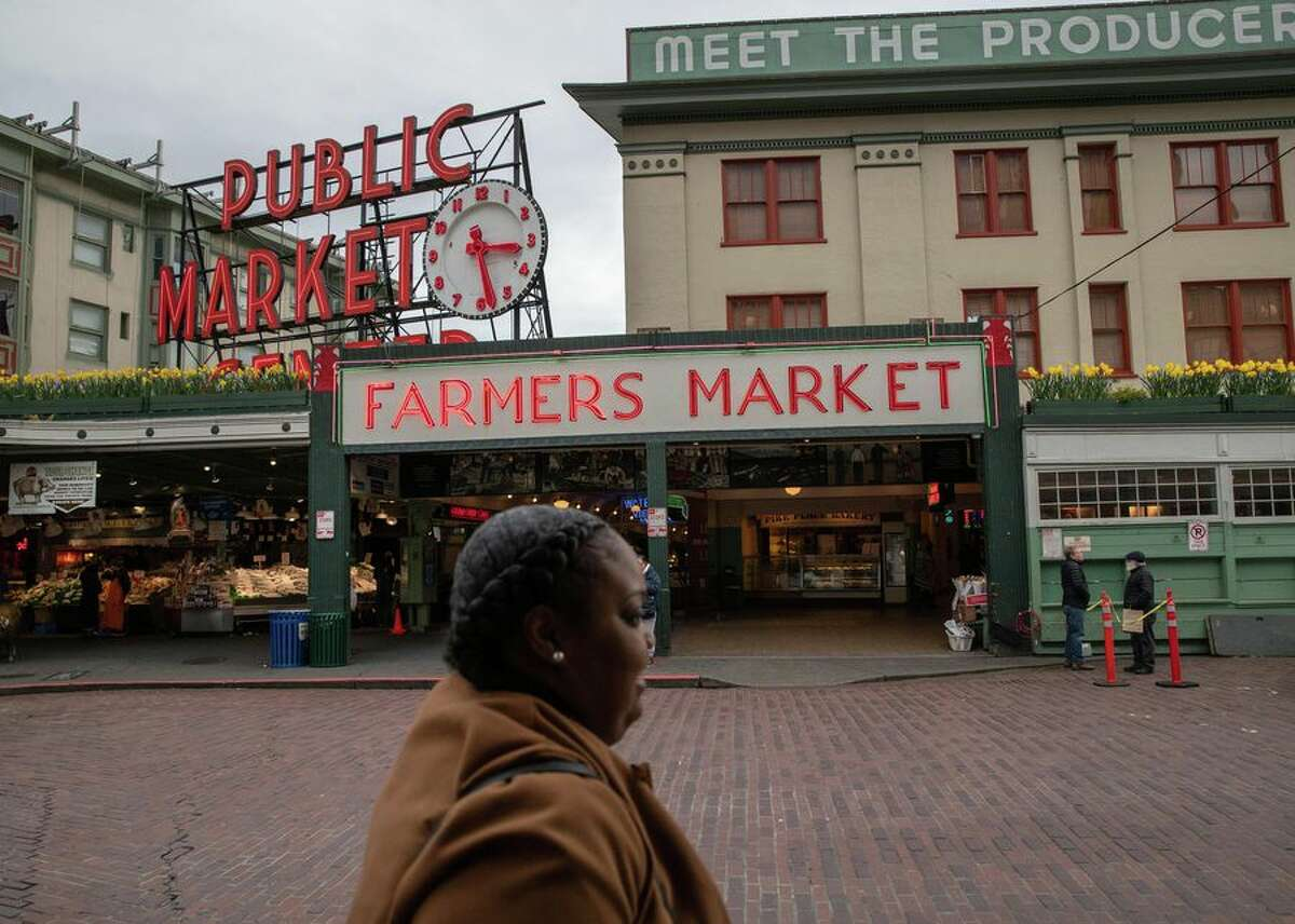 Seattle's usually bustling Pike Place Market sits mostly empty of patrons on March 10, 2020.