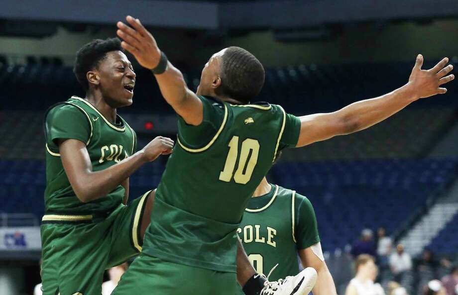 Adreaell Ray, left, and Andrew Reed celebrate the victory after the class 3A state semifinal boys basketball game between Cole and Peaster at the Alamodome on Feb. 12, 2020. Photo: Tom Reel, San Antonio Express-News / Staff Photographer / **MANDATORY CREDIT FOR PHOTOG AND  SAN ANTONIO EXPRESS-NEWS/NO SALES/MAGS OUT/TV