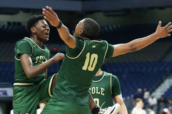 Cole players Adreaell Ray, left, and Andrew Reed celebrate their victory in the Class 3A state semifinal against Peaster at the Alamodome on Feb. 12, 2020.