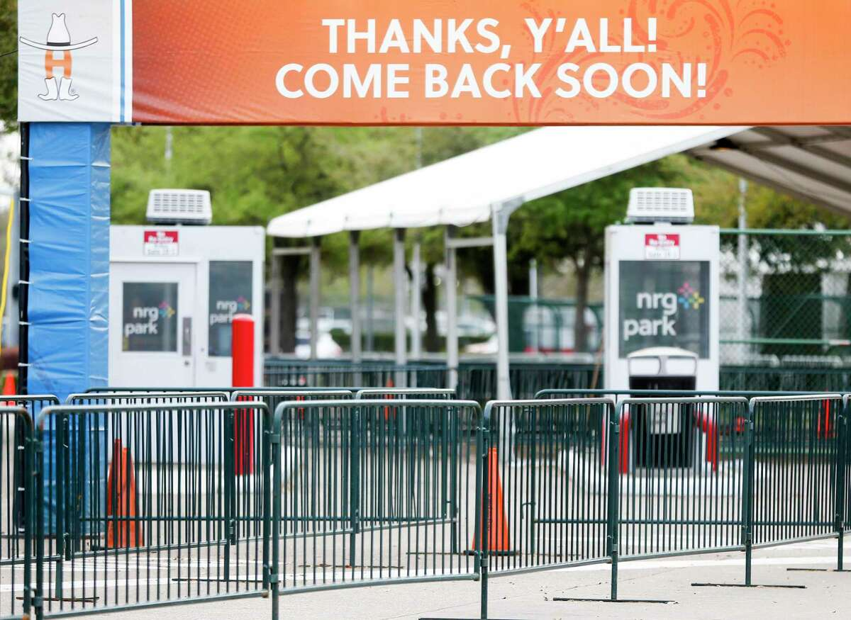 The carnival area of the Houston Livestock Show and Rodeo was near empty after the announcement of the rodeo closing early on Wednesday, March 11, 2020. An organizer says four coronavirus cases are now connected to a Houston rodeo cookoff tent.