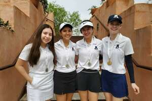 Alexander placed second in a one-day tournament Thursday at the Max A. Mandel Municipal Golf Course led by Emily Edmond, right, who won the individual title.
