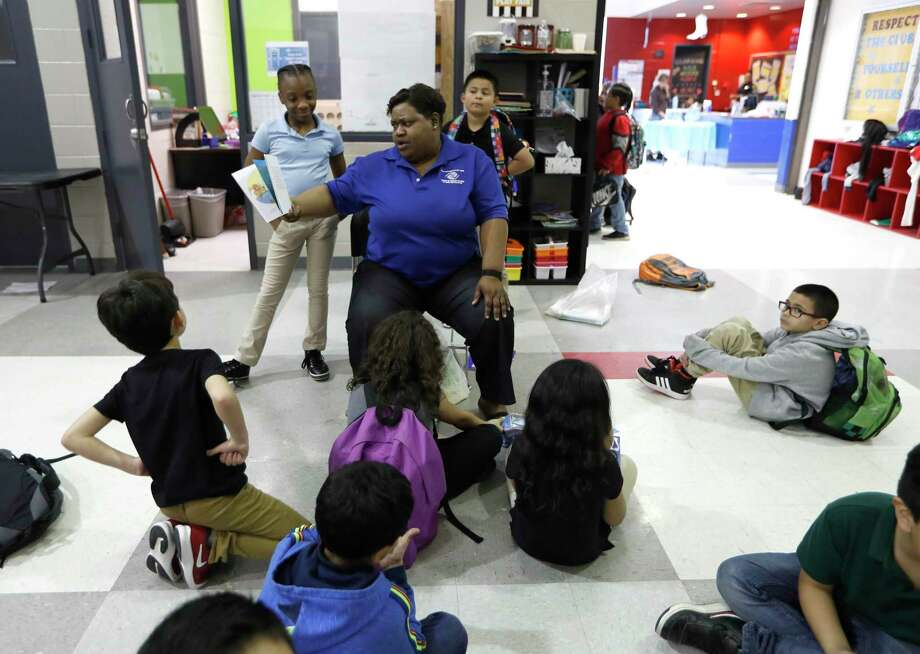 Myra Coleman, lead staffer reads to children at the Heights Boys and Girls Club, in Houston, Thursday, March 12, 2020. While local health officials are still recommending that schools remain open amid coronavirus fears, most area school districts announced they would close for at least a week. Photo: Karen Warren, Houston Chronicle / Staff Photographer / © 2020 Houston Chronicle