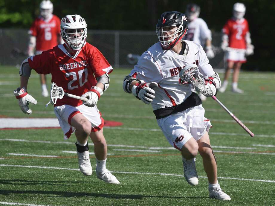 New Canaan's Justin Wietfeldt (33) breaks away from Greenwich's Jack O'Gorman (2) during an FCIAC boys lacrosse quarterfinal game at New Canaan's Dunning Field on Saturday, May 18, 2019. Photo: Dave Stewart / Hearst Connecticut Media / Hearst Connecticut Media