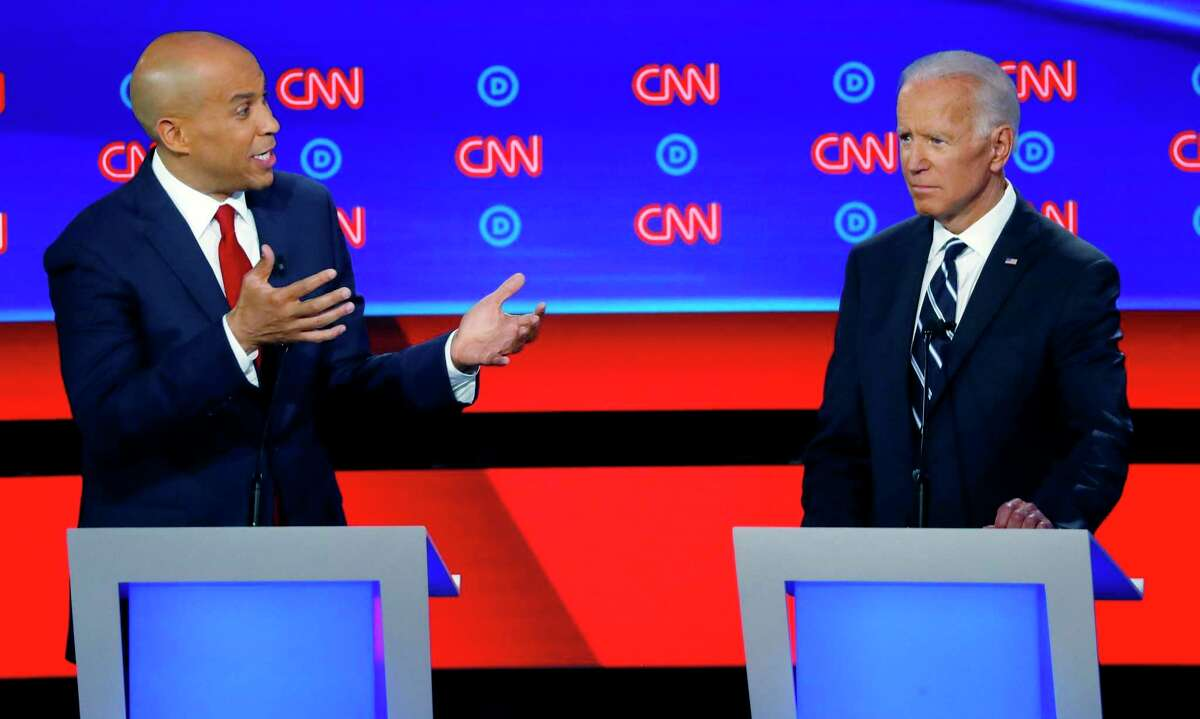 FILE - In this July 31, 2019 file photo, Sen. Cory Booker, D-N.J., gestures to former Vice President Joe Biden during the second of two Democratic presidential primary debates hosted by CNN in the Fox Theatre in Detroit. Booker of New Jersey has endorsed Joe Biden. Booker announced on Twitter early Monday that Biden will
