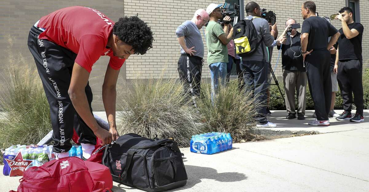 Houston Cougars guard Nate Hinton (11) gathers his belongings after the team unloaded their bus on Thursday, March 12, 2020, at the University of Houston in Houston. The team, which was heading to Fort Worth for the American Athletic Conference Championship, returned to the university after receiving news of the cancellation of the tournament this morning, due to concerns about COVID-19.