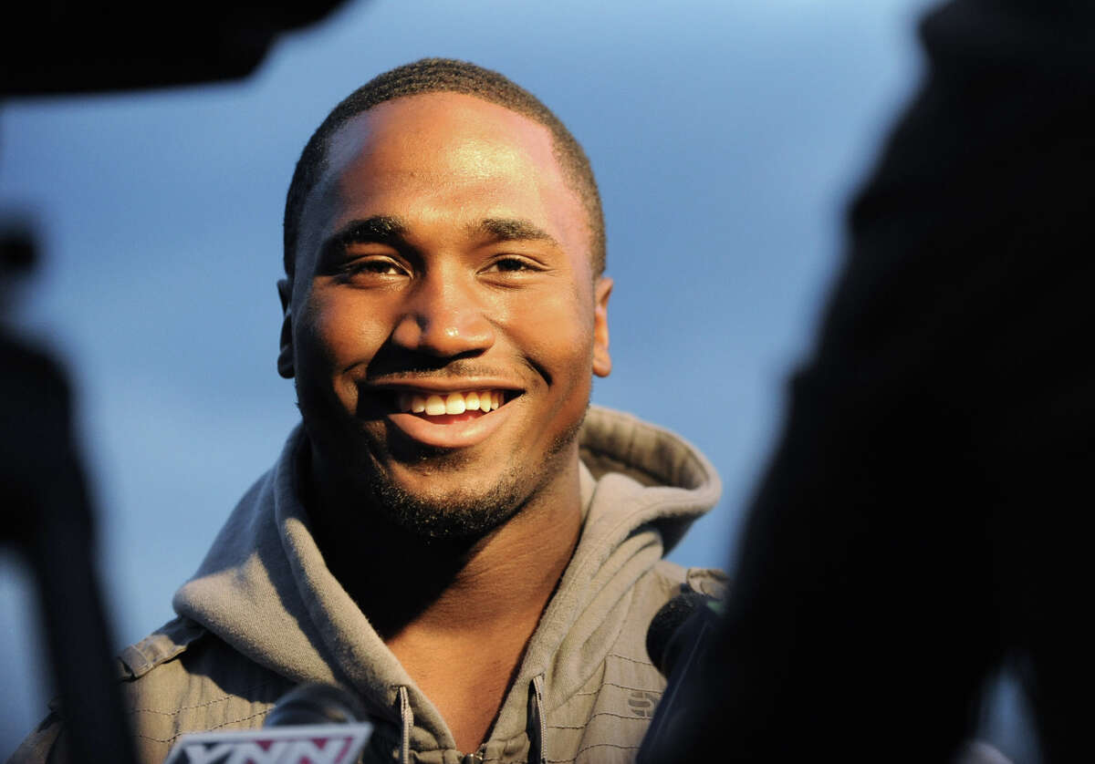 Dion Lewis of Albany and the Philadelphia Eagles talks to the press before a Pop Warner football practice at Hoffman's Park in Albany, N.Y. Thursday, Oct. 20, 2011. Members of the Albany Police Athletic League (PAL) joined Albany PAL alumni Dion Lewis to present more than $4,000 worth of new youth football gear to youth of the Pop Warner program. (Lori Van Buren / Times Union)
