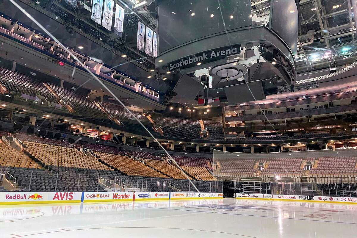 Fresh surfaced ice at Scotiabank Arena, home of the NHL hockey club Toronto Maple Leafs, is shown in Toronto, Thursday, March 12, 2020. The NHL is following the NBAa€™s lead and suspending its season amid the coronavirus outbreak, the league announced Thursday.(Joshua Clipperton/The Canadian Press via AP)